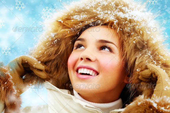 Happy girl in furry hood - Stock Photo - Images