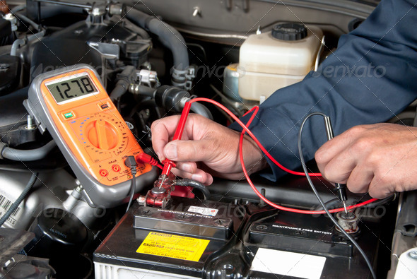 PhotoDune Auto mechanic checking car battery voltage 901432