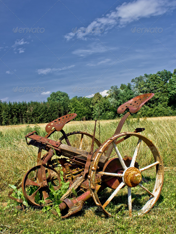 Traditional rusty horse powered grass mower & haymaker - Stock Photo - Images