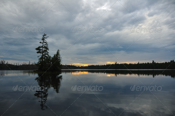 Scenic Island on a Remote Wilderness Lake at Dusk - Stock Photo - Images