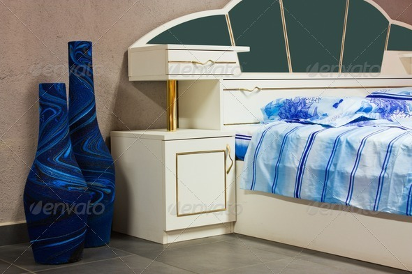 Bedroom, bed with sheets and night-tables - Stock Photo - Images
