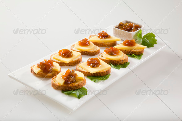 Bagel crisps with chutney and cheese - Stock Photo - Images