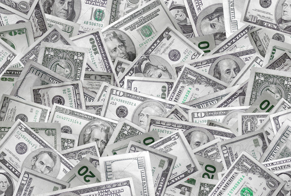 A large pile of money making a background.