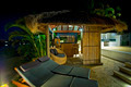 Resort style living with Bali hut with bar and deck chairs - PhotoDune Item for Sale