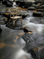 Long exposure rattan chair at waterfall. - PhotoDune Item for Sale