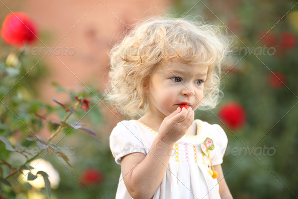 Child in garden - Stock Photo - Images