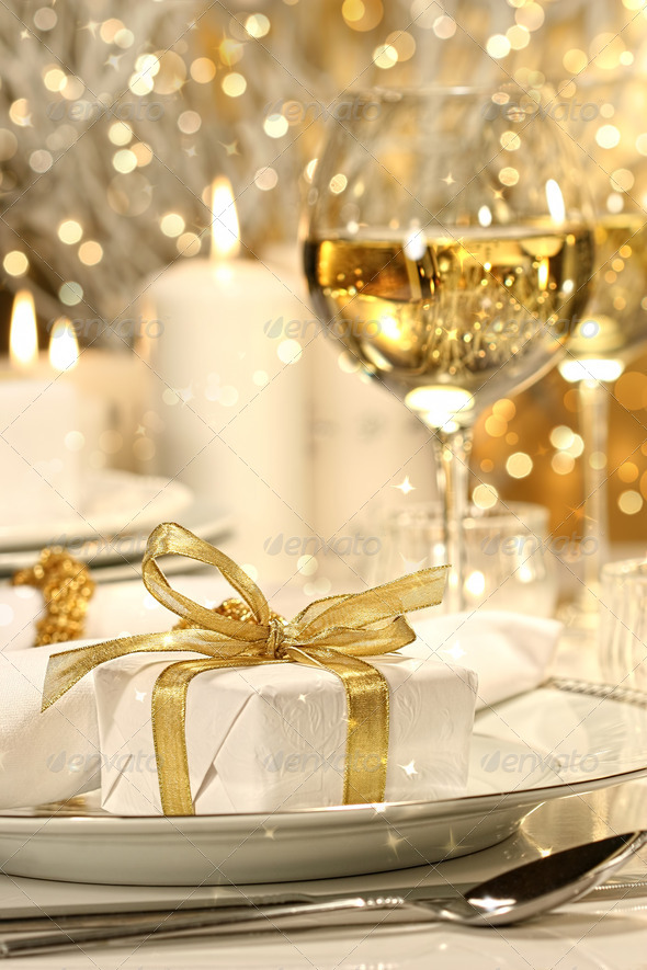 Gold ribbon gift with gold background - Stock Photo - Images