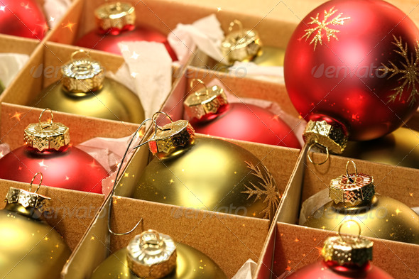 Christmas balls in box with paper wrapping - Stock Photo - Images