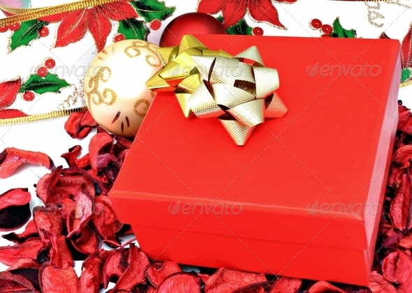 Red box with Christmas golden ball - Stock Photo - Images