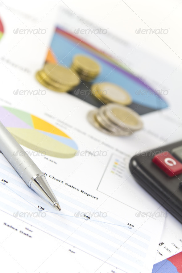 Business Finance Charts and Graphs with Coins - Stock Photo - Images