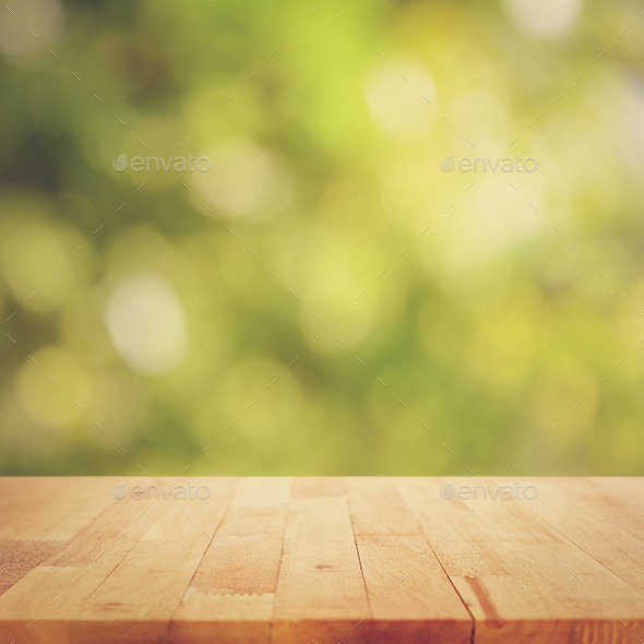 Wood table top on green bokeh background - vintage tone Stock Photo by ...