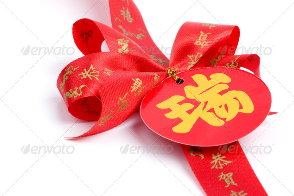 Red bow and chinese alphabet - Stock Photo - Images