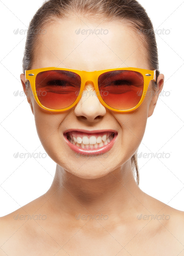 funny teenage girl in shades - Stock Photo - Images