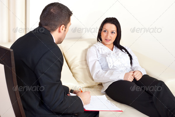 PhotoDune Patient woman talking with psychologist man 1075478