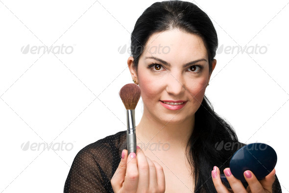 Woman with brush for blush and mirror - Stock Photo - Images