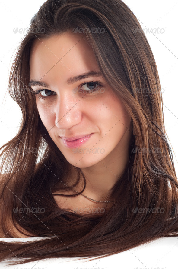portrait of a pretty brunet young woman with healthy brown hair - Stock Photo - Images
