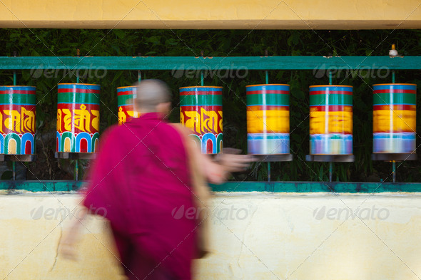 Buddhist monk rotating prayer wheels in McLeod Ganj - Stock Photo - Images