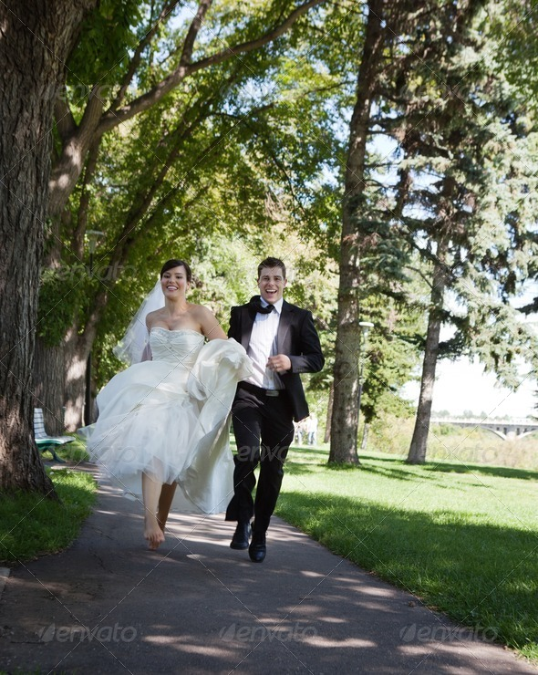 Bride and Groom Running - Stock Photo - Images