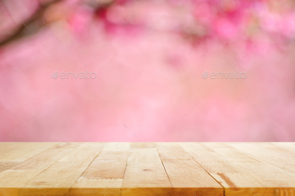 Wood table top on blurred background of pink cherry blossom flowers ...