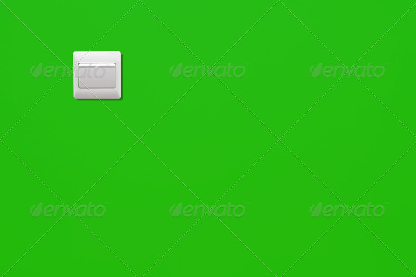 White power switch on a green wall of an energy saving room - Stock Photo - Images