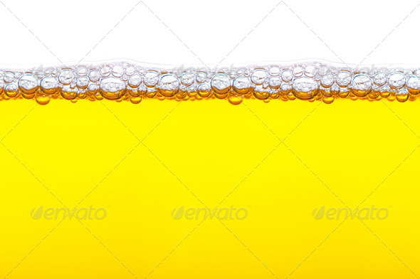 close up shot of yellow beer with foam and bubbles on white back - Stock Photo - Images
