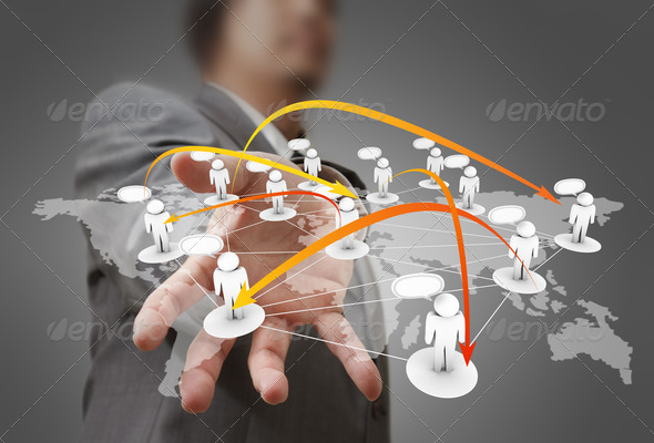 Businessman hand holds social network - Stock Photo - Images