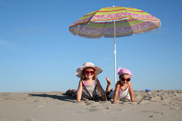 Two little girl fun on the beach - Stock Photo - Images