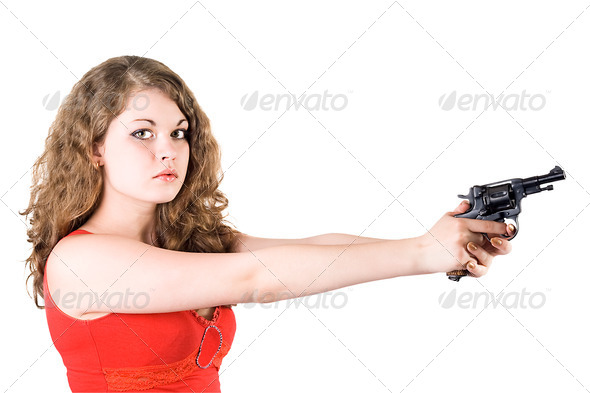 Young woman with a revolver. Isolated on white - Stock Photo - Images