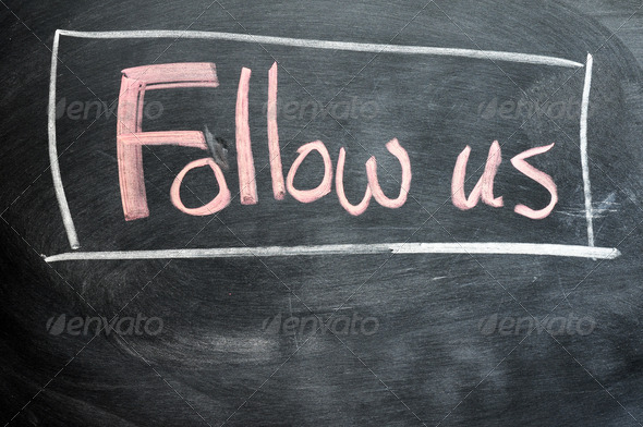 Follow us written on a blackboard - Stock Photo - Images