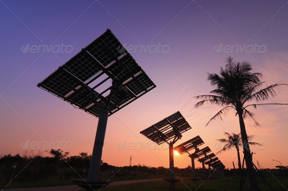 silhouette of solar panel with beautiful sunset - Stock Photo - Images