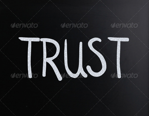 "The word ""Trust"" handwritten with white chalk on a blackboard - Stock Photo - Images"