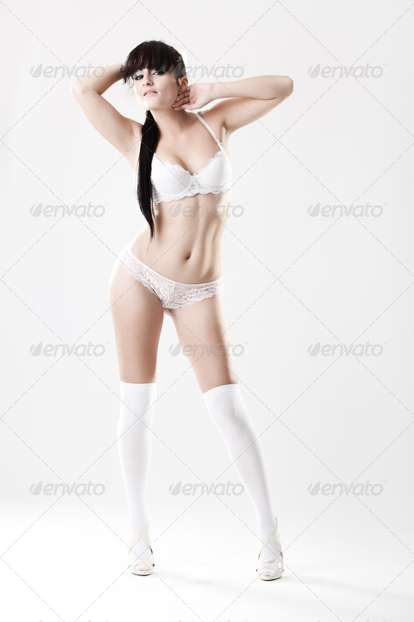 Sexy young female in white lingerie, stockings and heels - Stock Photo - Images