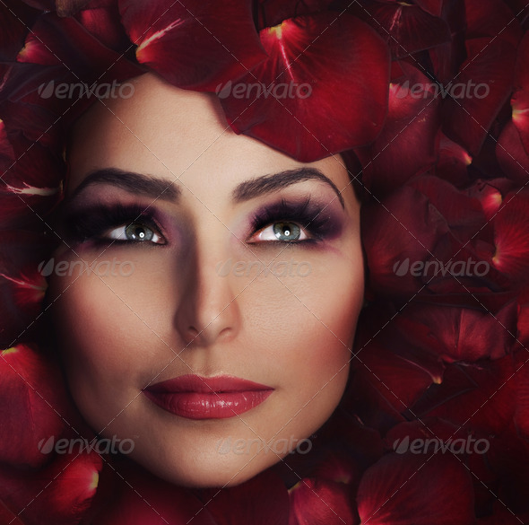 Beautiful Woman&#x27;s Face And Rose Petals. Perfect Skin - Stock Photo - Images