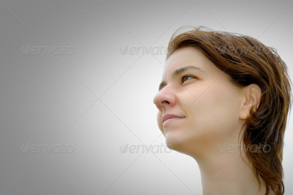 Young woman looking at copyspace - Stock Photo - Images