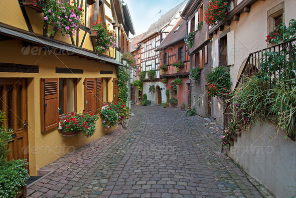 Narrow street in Alsace, France - Stock Photo - Images