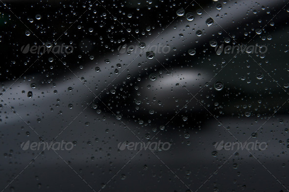 metal silver car in the rain - Stock Photo - Images