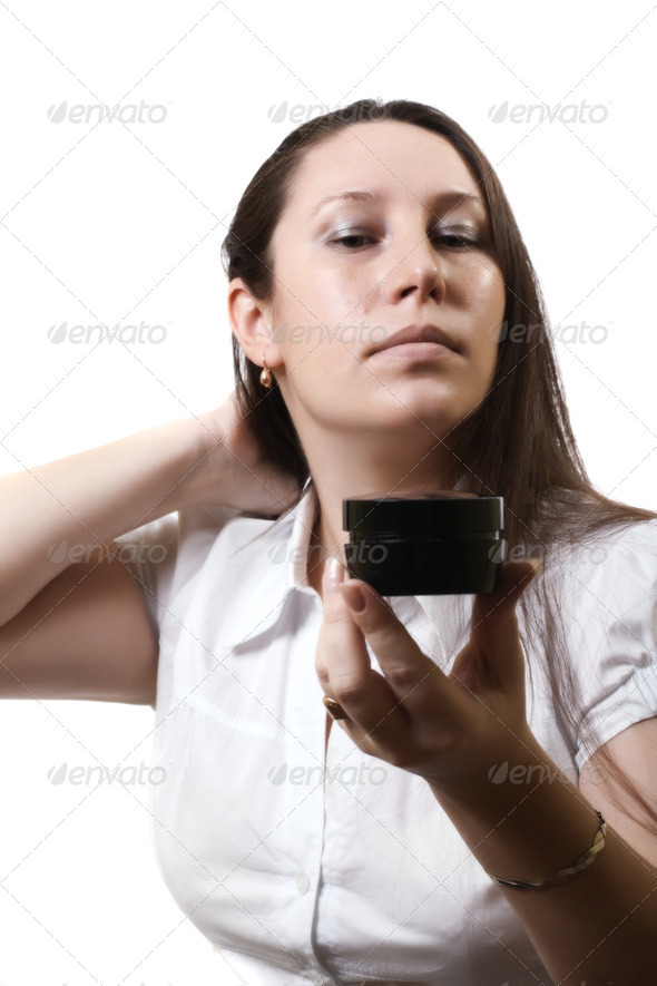 woman and a cosmetic cream - Stock Photo - Images
