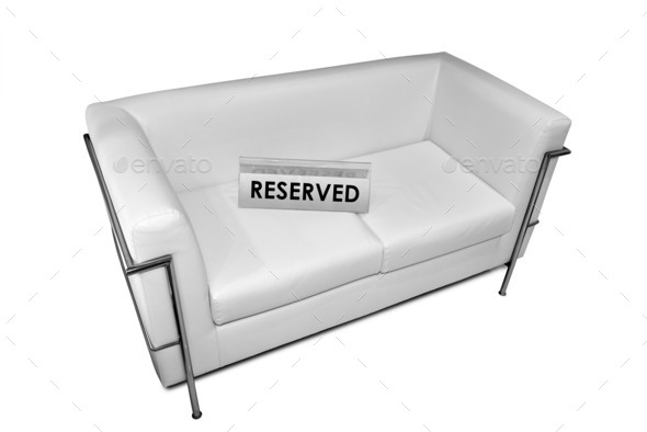 reserved sign on white leather sofa