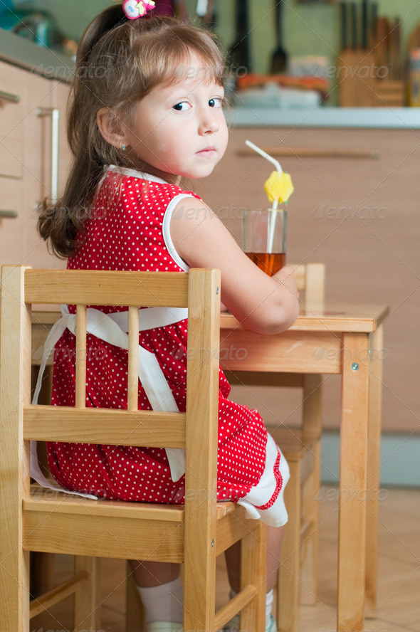 Royalty Free Stock Photography : a little girl at a table Photodune 1204397