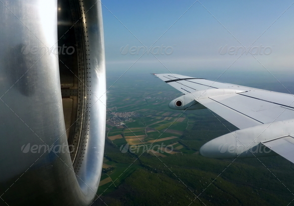Flying plane wing and motor - Stock Photo - Images