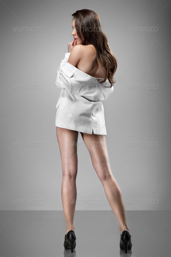 portrait of sexy woman in white jacket - Stock Photo - Images