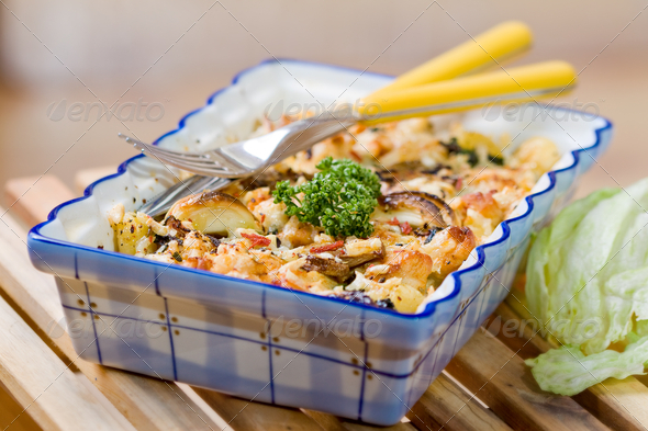 Roast gnocchi with spinach and chicken meat - Stock Photo - Images