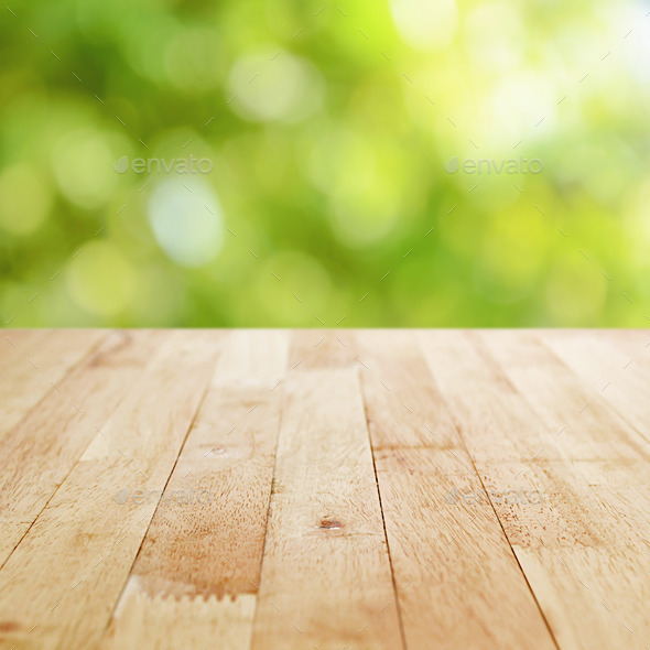 Wood table top on blur green bokeh background stock photo