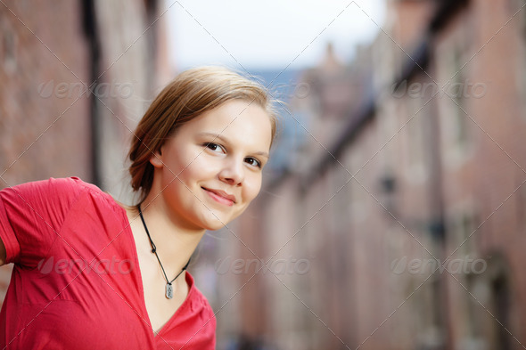 Pretty blond woman in red dress - Stock Photo - Images