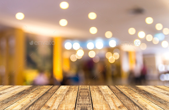 Old wooden table with blurred hotel lobby background Stock ...