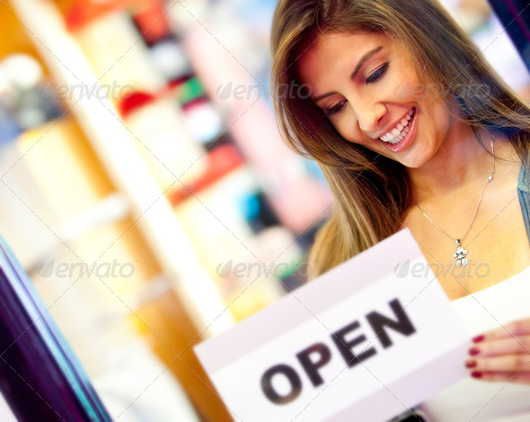 Stock Photo - PhotoDune Woman opening a business 1302143