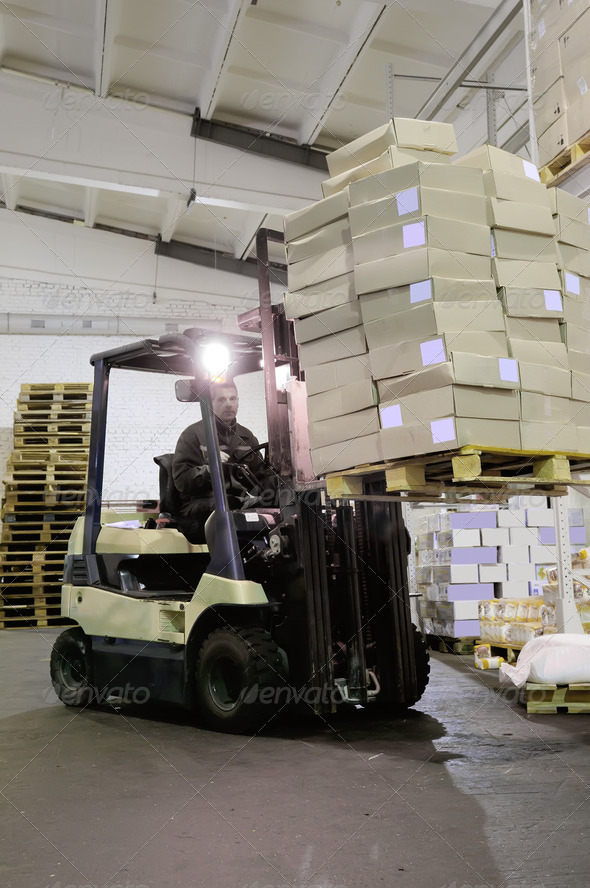 Forklift in warehouse - Stock Photo - Images