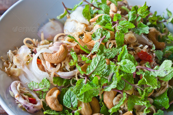 Thai dressed salad, mix of lemongrass and spice, close up - Stock Photo - Images