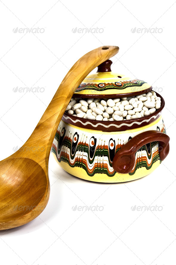 Wooden Spoon and colorful ceramic pot - Stock Photo - Images