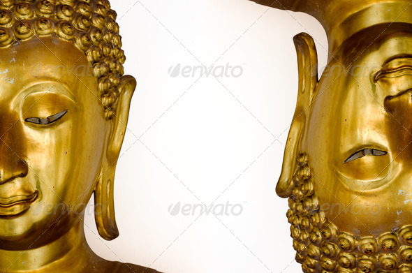 Two half face of gold buddha image - Stock Photo - Images